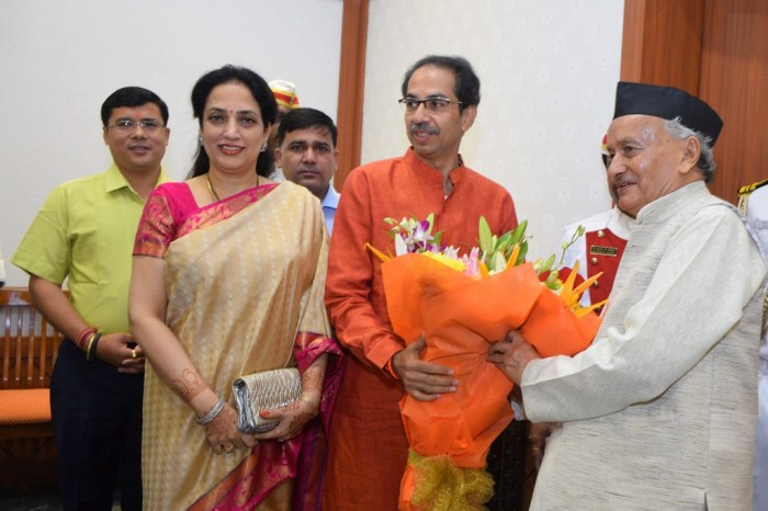 Mumbai: Maharashtra Governor Bhagat Singh Koshyari receives a bouquet from state Chief Minister-designate Uddhav Thackeray and his wife Rashmi Thackeray, at Raj Bhavan in Mumbai, Wednesday, Nov. 27, 2019. (PTI Photo) (PTI11_27_2019_000048B)