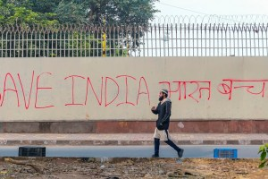 New Delhi: A man walks past anti-Citizenship Amendment Act (CAA) graffiti in New Delhi, Saturday, Dec. 21, 2019. (PTI Photo/Vijay Verma)(PTI12_21_2019_000158B)