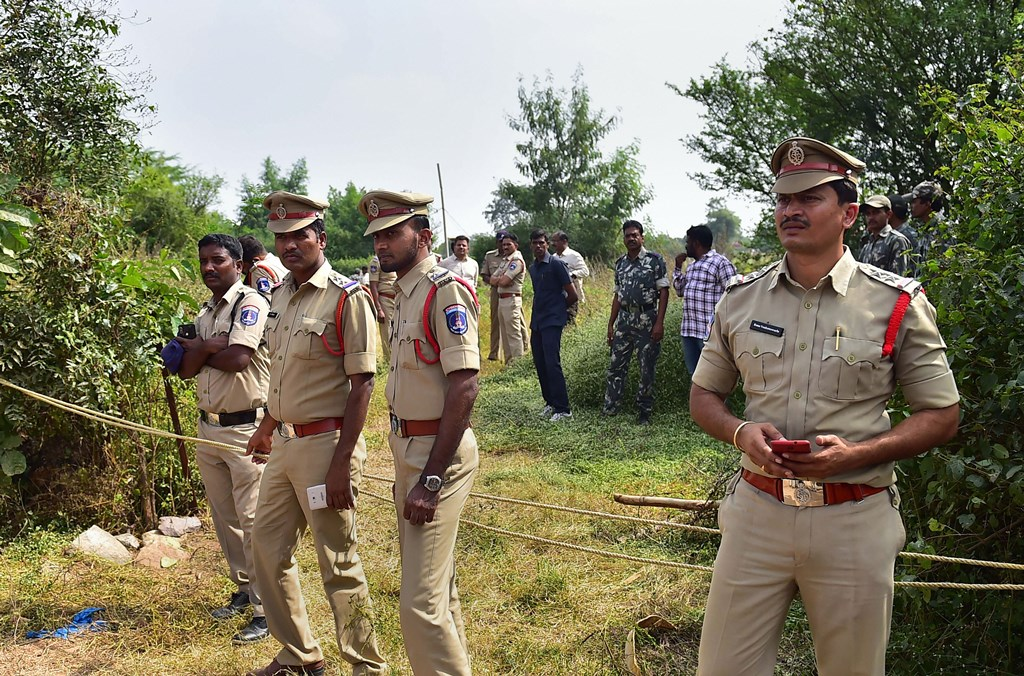 Hyderabad: Policemen stand guard the area where four accused in the rape-and-murder case of a 25-year-old woman veterinarian were shot dead by police, at Shadnagar of Ranga Reddy district in Hyderabad, Friday, Dec. 6, 2019. (PTI Photo/Shailendra Bhojak)(PTI12_6_2019_000075B)