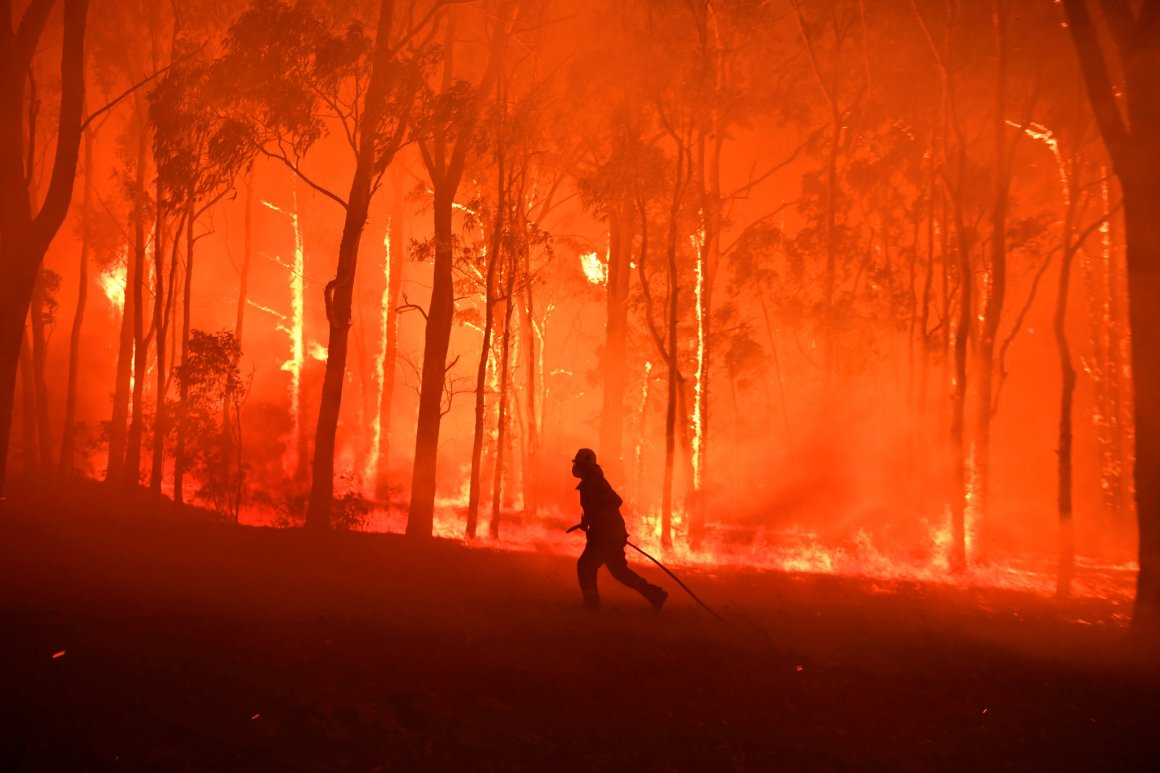 A firefighter near Colo Heights, Australia, northwest of Sydney, on Tuesday.Credit...Reuters