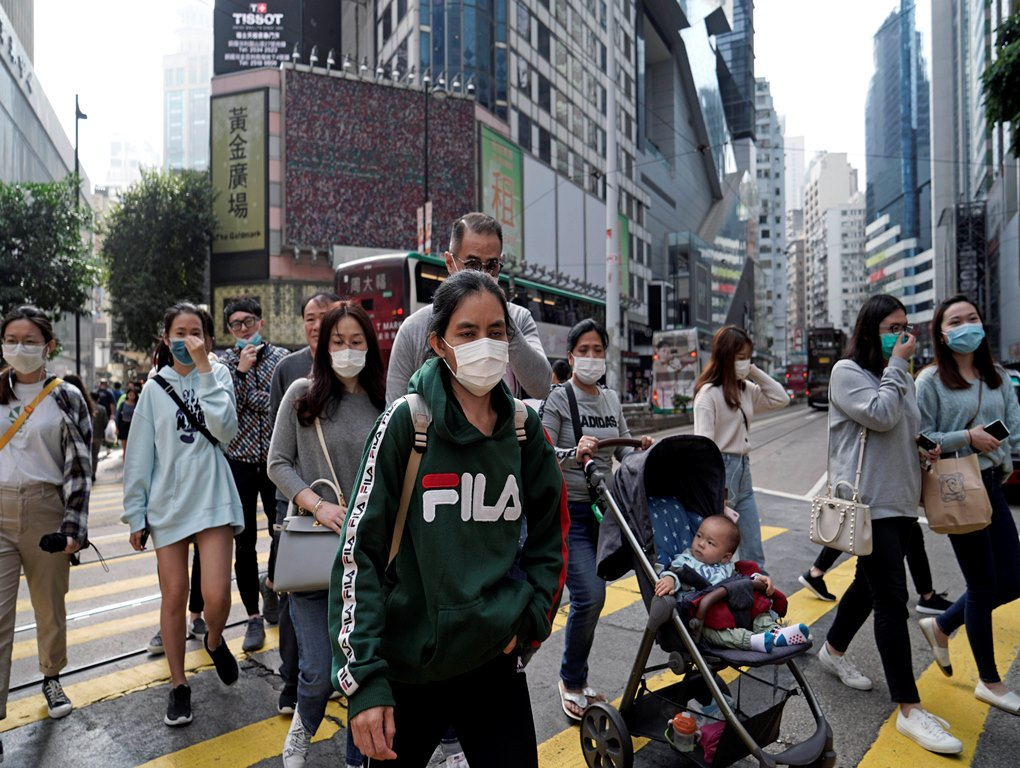Hong Kong: People wear masks on a street in Hong Kong, Friday, Jan. 24, 2020 to celebrate the Lunar New Year which marks the Year of the Rat in the Chinese zodiac. Cutting off access to entire cities with millions of residents to stop a new virus outbreak is a step few countries other than China would consider, but it is made possible by the ruling Communist Party's extensive social controls and experience fighting the 2002-03 outbreak of SARS. AP/PTI(AP1_24_2020_000076B)