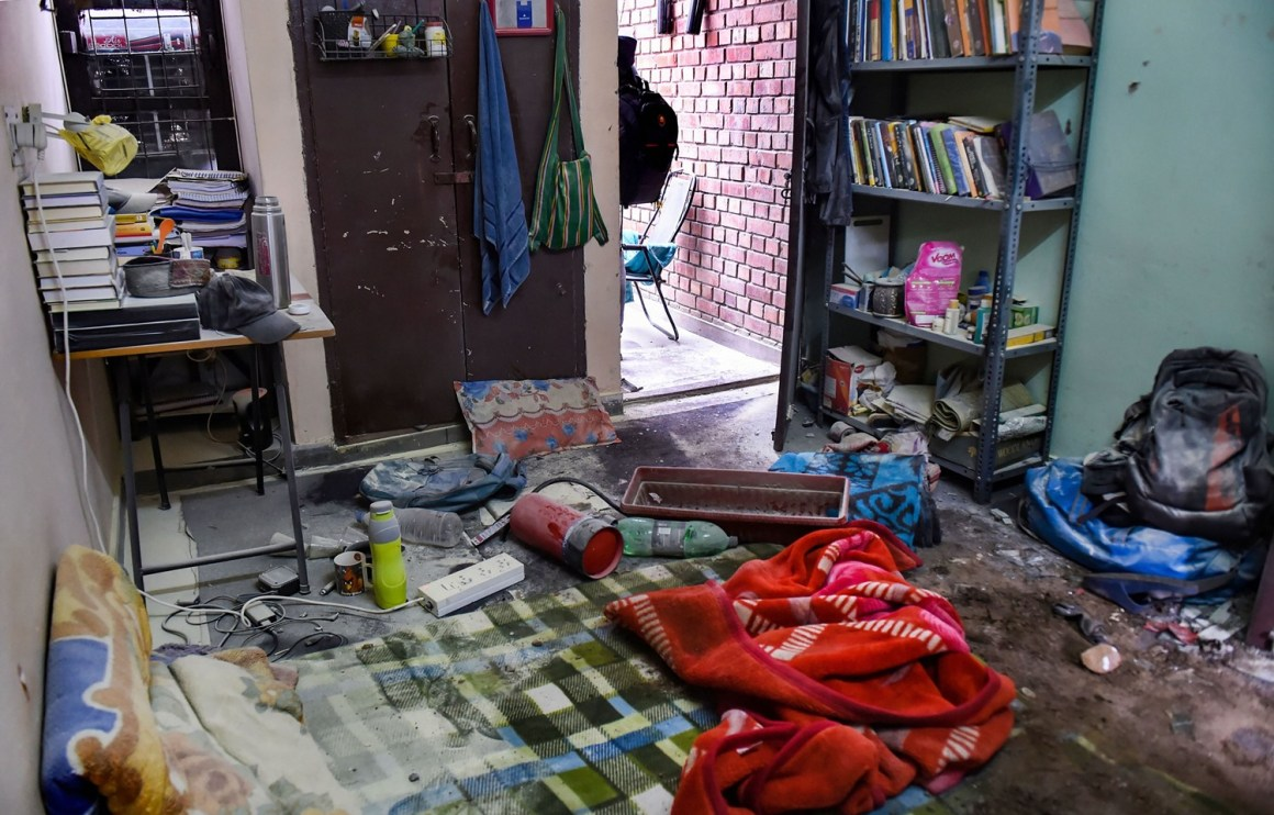New Delhi: Articles scattered in a room of the Sabarmati Hostel following Sunday's violence at the Jawaharlal Nehru University (JNU) , in New Delhi, Monday, Jan. 6, 2020. A group of masked men and women armed with sticks, rods and acid allegedly unleashed violence on the campus of the University, Sunday evening. (PTI Photo/Atul Yadav) (PTI1_6_2020_000073B)