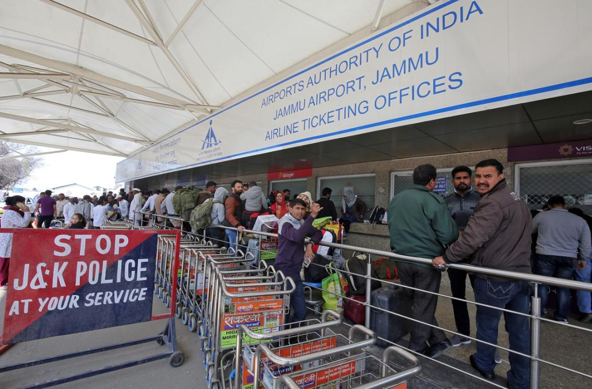 Passengers are seen at the ticket counters outside the airport after flights were cancelled following temporarily suspension of flights, in Jammu February 27, 2019. REUTERS/Mukesh Gupta