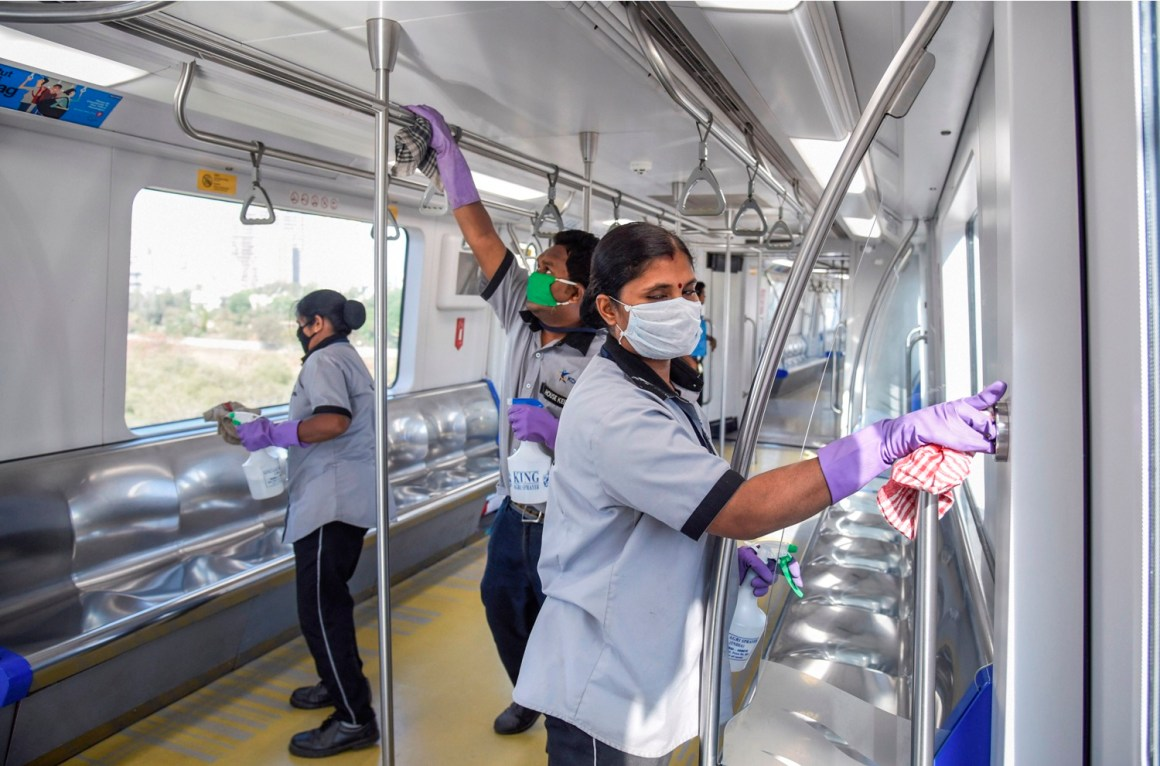 Mumbai: Workers sanitize Mumbai Metro in the wake of coronavirus pandemic in Mumbai, Thursday, March 19, 2020. (PTI Photo)(PTI19-03-2020_000204B)