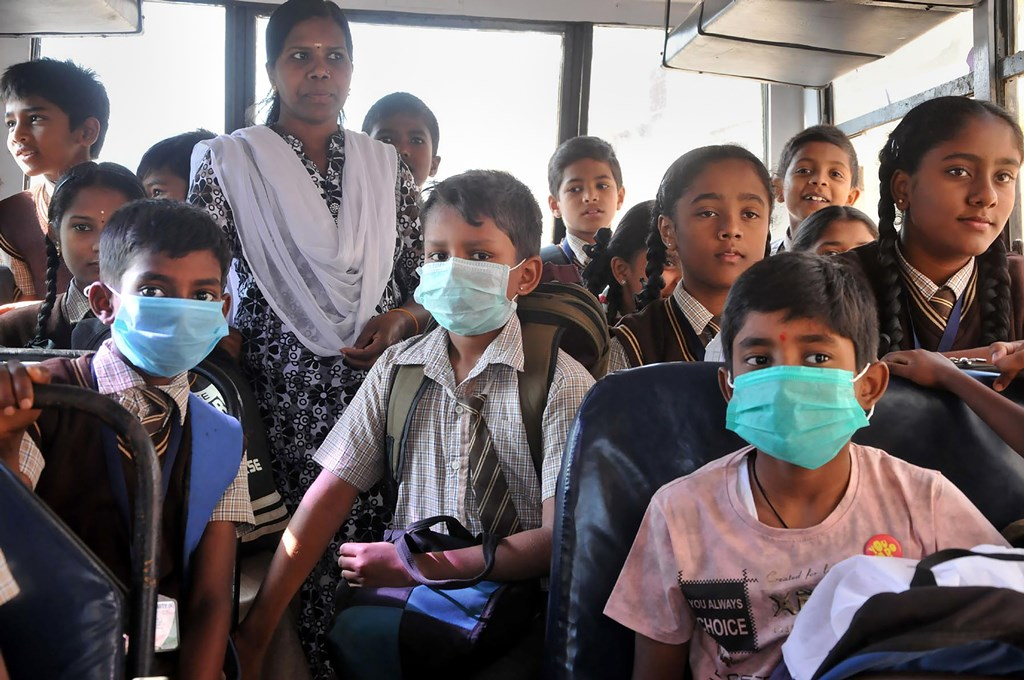 Chikmagalur: Students wear protective masks in the wake of the novel coronavirus (COVID-19) outbreak in Chikmagalur, Friday, March 13, 2020. India has more than 70 positive coronavirus cases so far and recorded its first COVID-19 death in Karnataka. (PTI Photo)(PTI13-03-2020_000056B)