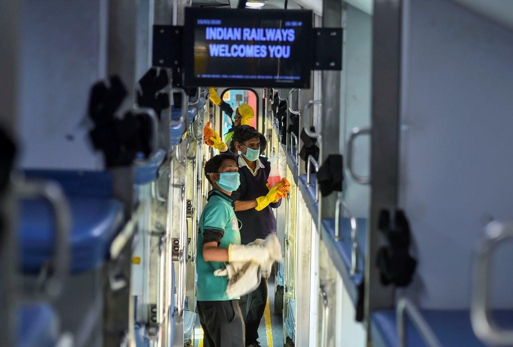 New Delhi: Railway workers disinfect the coaches of Delhi –Jammu Rajdhani Express train in wake of coronavirus pandemic at New Delhi Railway Station, Sunday, March 15, 2020. (PTI Photo/Arun Sharma)(PTI15-03-2020_000118B)