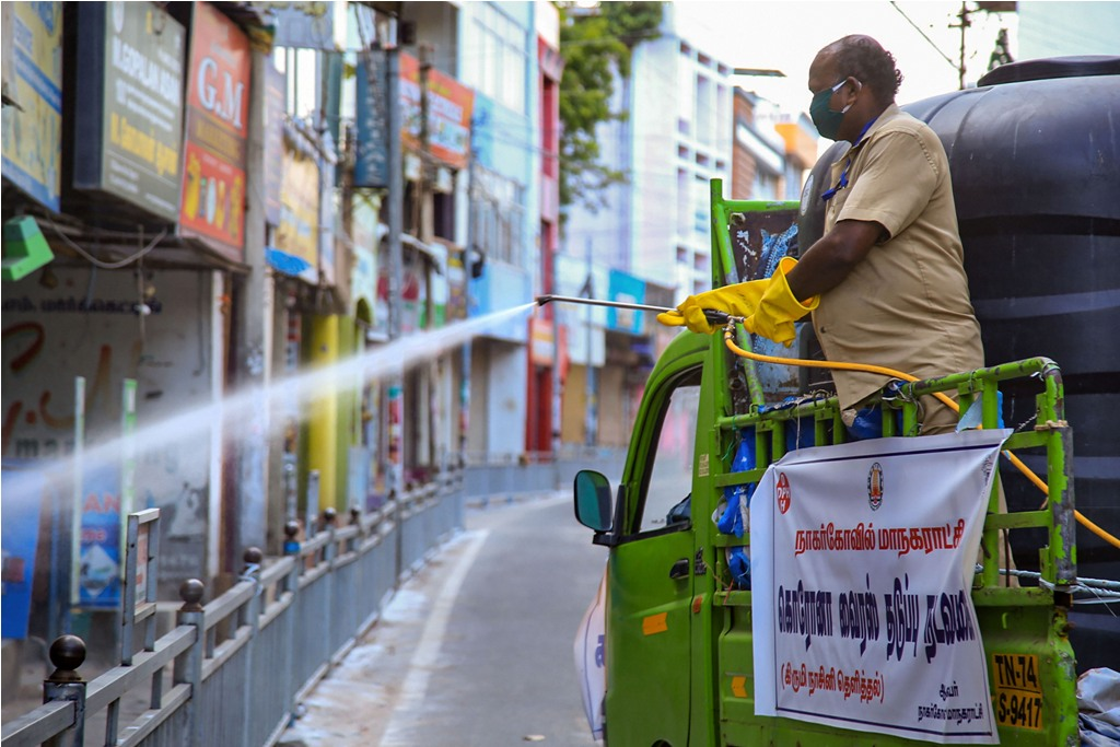 Kanyakumari: Nagercoil Corporation worker sprays disinfectants on a road amid concerns over the spread of the COVID-19 disease, caused by the novel coronavirus, during total lockdown, in Kanyakumari, Wednesday, March 25, 2020. (PTI Photo)(PTI25-03-2020_000261B)