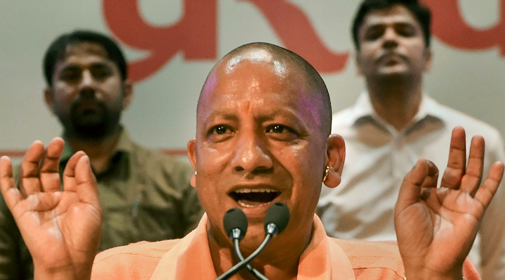Lucknow: Uttar Pradesh Chief Minister Yogi Adityanath addresses a press conference on completion of his three years in office at Lok Bhawan, in Lucknow, Wednesday, March 18, 2020. (PTI Photo/Nand Kumar)(PTI18-03-2020_000074B)