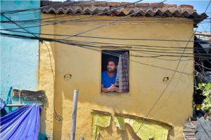 Noida: A man looks on throught the window of his house at a slum, during a nationwide lockdown to curb the spread of coronavirus, at Sec-8 in Noida, Wednesday, April 8, 2020. 200 people residing in the slum were taken to a quarantine facility on Tuesday night after they were traced to being in contact with positive COVID-19 patients. (PTI Photo/Vijay Verma)(PTI08-04-2020_000092B)