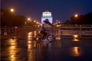 New Delhi: A cyclist makes way through rain in the backdrop of the India Gate, during a nationwide lockdown as a preventive measure against the coronavirus pandemic, in New Delhi, Friday, April 17, 2020. (PTI Photo/Manvender Vashist) (PTI17-04-2020 000253B)