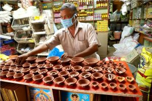 Kozhikode: A man arranges earthen lamps at his shop during a nationwide lockdown in the wake of the coronavirus outbreak, in Kozhikode, Saturday, April 4, 2020. PM Modi urged people to switch off lights of their homes at 9 pm for nine minutes on April 5 and light up lamps, candles, mobile flashlights to display the nation's collective spirit to defeat coronavirus. (PTI Photo) (PTI04-04-2020_000051B)
