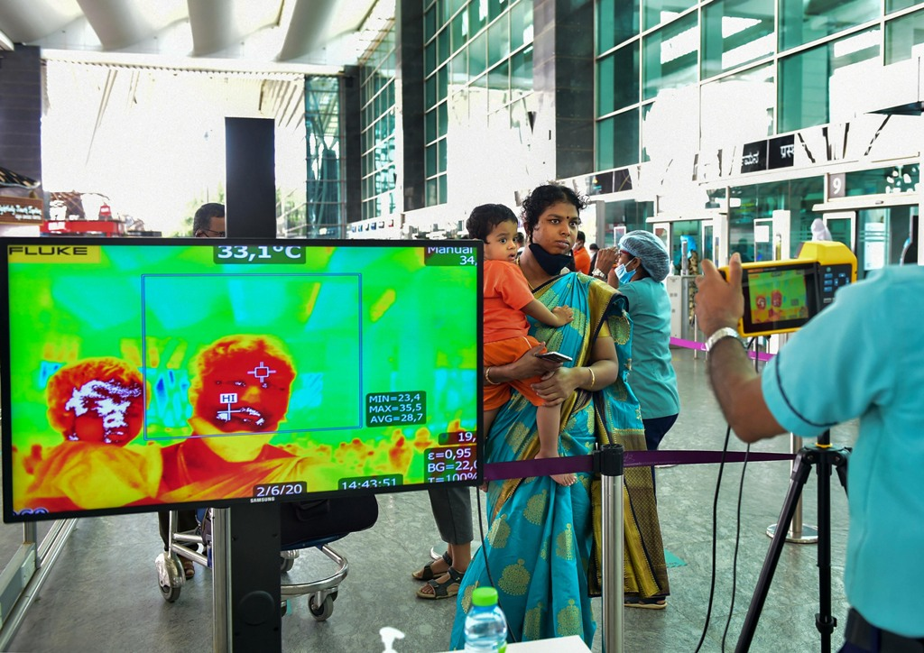 Bengaluru: Passengers undergo thermal screening at Kempegowda International airport after authorities eased restrictions, amid the ongoing COVID-19 nationwide lockdown, in Bengaluru, Tuesday, June 2, 2020. (PTI Photo/Shailendra Bhojak)