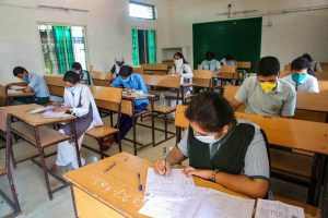 Bhopal: Students wearing protective masks appear in the higher secondary school examinations of Madhya Pradesh Board of Secondary Education, during the fifth phase of ongoing COVID-19 lockdown, in Bhopal, Tuesday, June 9, 2020. (PTI Photo) (PTI09-06-2020_000030B)