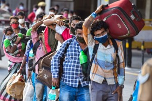 Chennai: Migrants stand in a queue at Central Railway Station to board a Shramik Special train for West Bengal, during ongoing COVID-19 lockdown, in Chennai, Wednesday, June 3, 2020. (PTI Photo/R Senthil Kumar) (PTI03-06-2020_000243B)