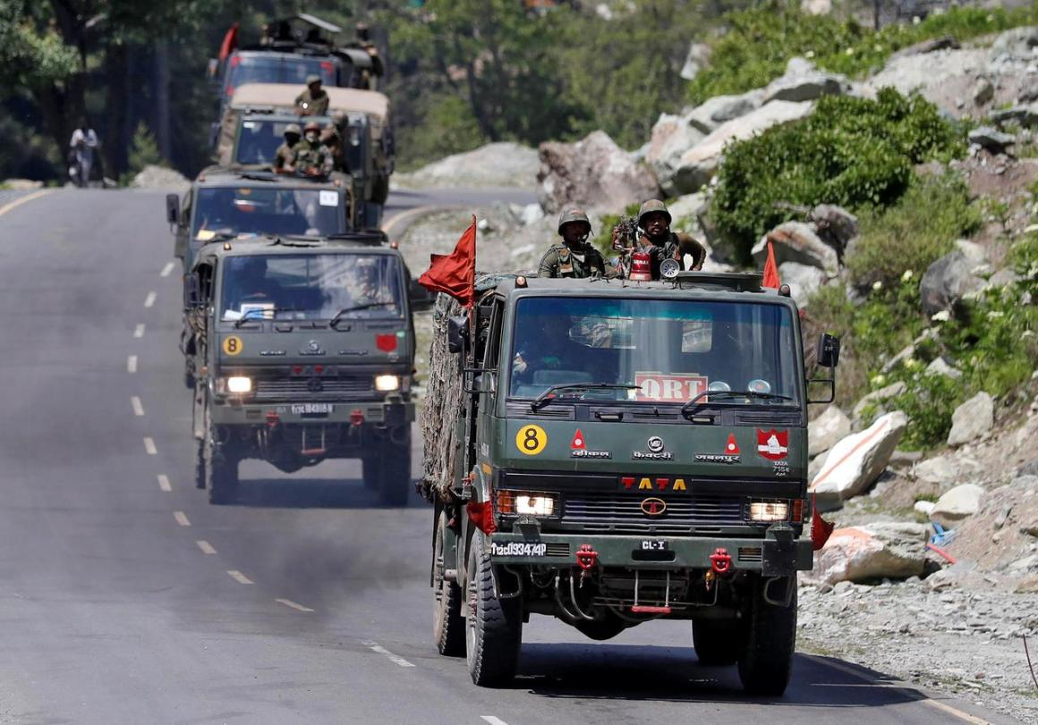 An Indian Army convoy moves along a highway leading to Ladakh, at Gagangeer in Kashmir's Ganderbal district June 18, 2020. REUTERS/Danish Ismail