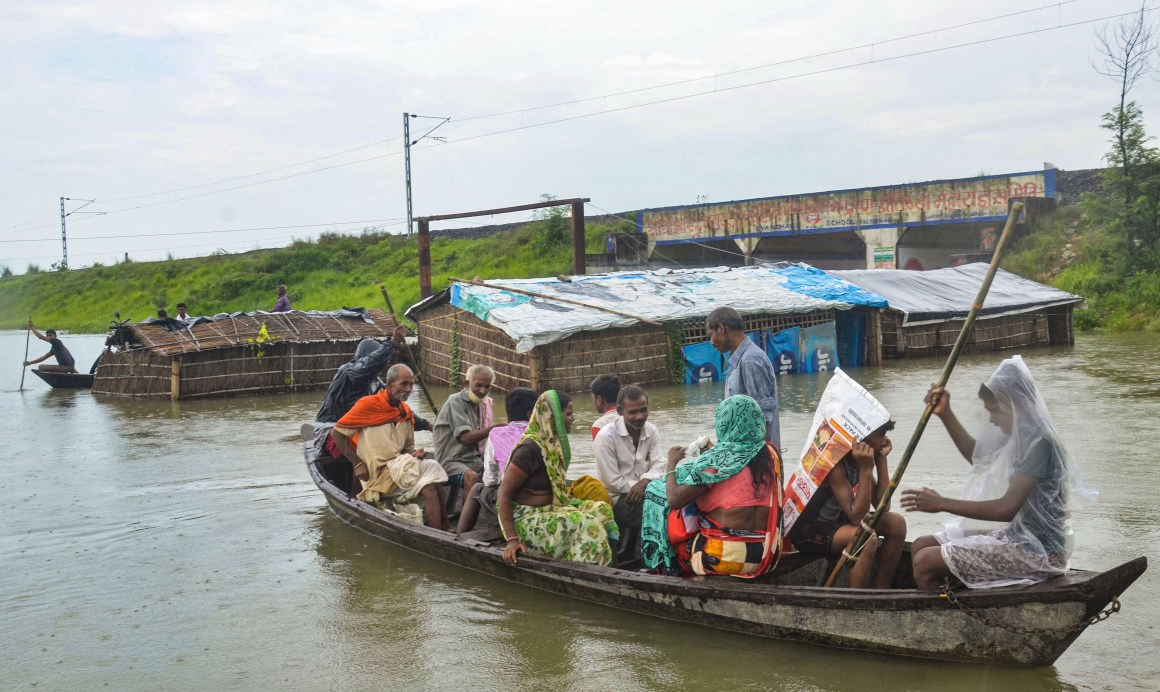 Muzaffarpur: Residents move to a safer place on a boat from a flood affected area, following heavy monsoon rain, in Muzaffarpur district, Tuesday, July 21, 2020. (PTI Photo)(PTI21-07-2020_000161B)