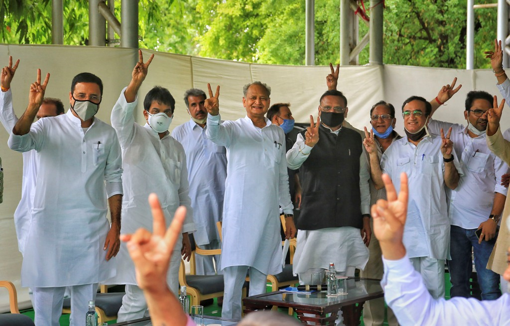 Jaipur: Rajasthan Chief Minister Ashok Gehlot (C) with senior Congress leaders Randeep Surjewala, Avinash Pandey, Ajay Maken and K.C. Venugopal flashes victory sign during a meeting with the party MLAs at his residence in Jaipur, Monday, July 13, 2020. (PTI Photo) (PTI13-07-2020 000059B)