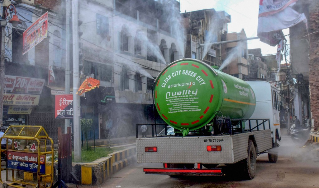 Allahabad: Municipal workers use a water tanker, modified to spray disinfectants, to sanitise a locality as COVID-19 cases surge, in Allahabad, Saturday, Aug. 8, 2020. (PTI Photo)