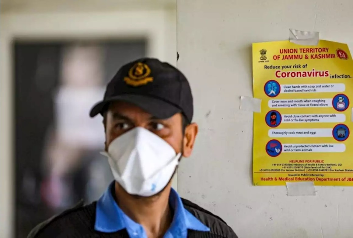 A security guard wears a mask as a preventive measure against coronavirus, at a special ward of a hospital, in J&K (PTI Photo)