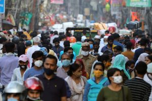 People are seen at a market amidst the spread of the coronavirus disease (COVID-19), in the old quarters of Delhi, October 19, 2020. REUTERS/Anushree Fadnavis/Files
