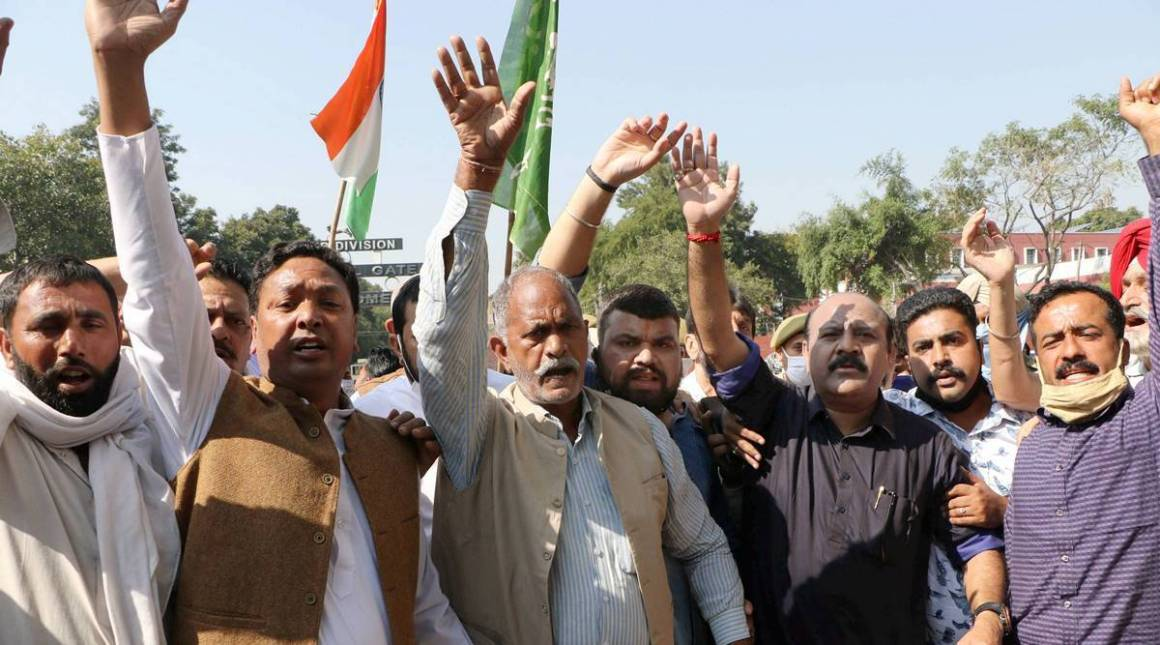 Workers of the Peoples Democratic Party (PDP) shout slogans during a protest rally against the Centre, in Jammu, Wednesday , Oct. 28, 2020. (PTI Photo)
