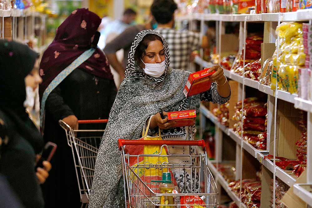 People shop for food in a government-run supermarket, which provide special discount prices for the upcoming Muslim fasting month of Ramadan, in Islamabad, Pakistan. (File Photo: PTI)
