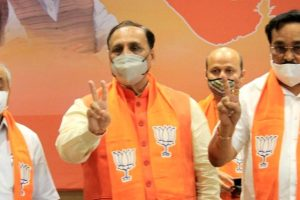 Gandhinagar: Gujarat CM Vijay Rupani (C), Deputy CM Nitin Patel (L) and BJP State President CR Patil flash the victory sign during counting of votes for Madhya Pradesh bypolls and Bihar Assembly polls, in Gandhinagar, Tuesday, Nov. 10, 2020. (PTI Photo)(PTI10-11-2020 000067B)