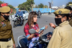 Amritsar: Policewomen urge a commuter to wear mask during a campaign to curd Covid-19 spread in Amritsar on Tuesday, December 1, 2020. PTI Photo