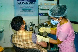 Bhopal: A medic administers Covaxin, developed by Bharat Biotech in collaboration with the Indian Council of Medical Research (ICMR), during the Phase- 3 trials at the Peoples Medical College in Bhopal, Monday, Dec. 7, 2020. (PTI Photo)(PTI07-12-2020 000173B)
