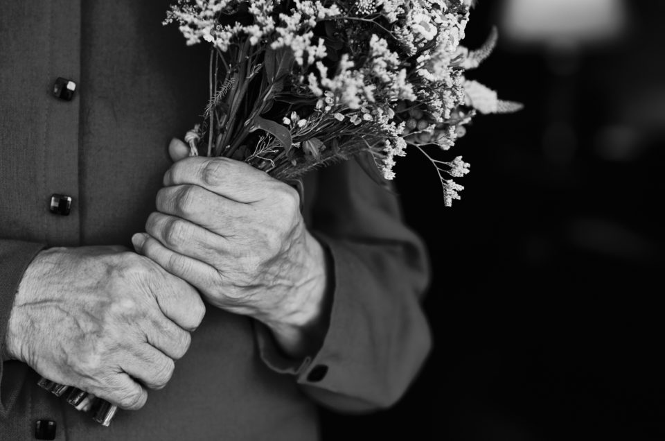 Senior man holding flowers