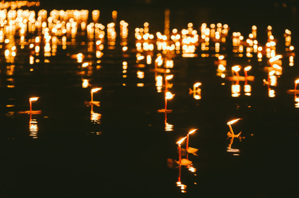 Water lantern in river at night in Loy Krathong Festival in Thailand