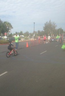 My son pedaling as fast as he could to beat out his fellow Nickelodeon watching people.