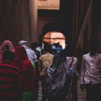 photo of people walking towards gate