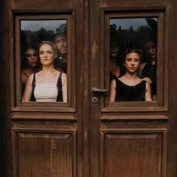 people standing behind door with window