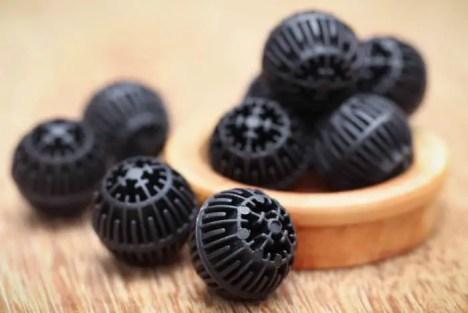 black bio balls for biological filtration in an aquarium filter