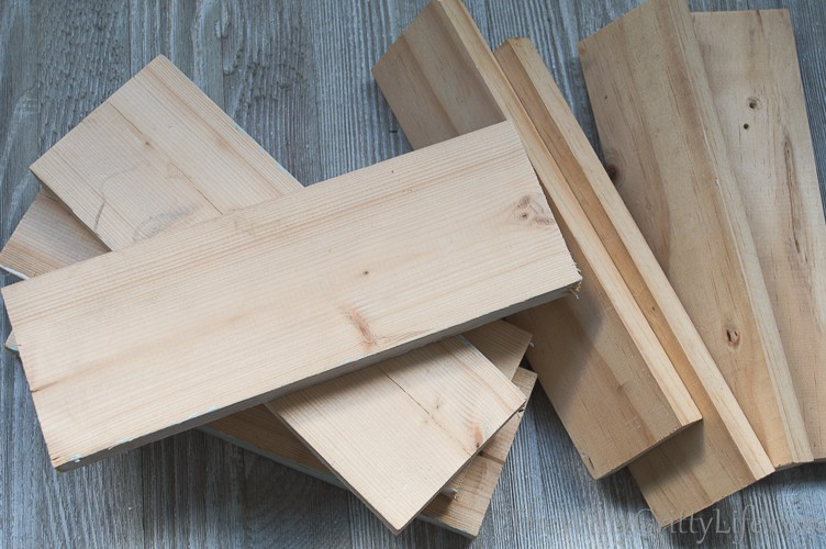 a pile of scrap wood boards about to be turned into lamp columns