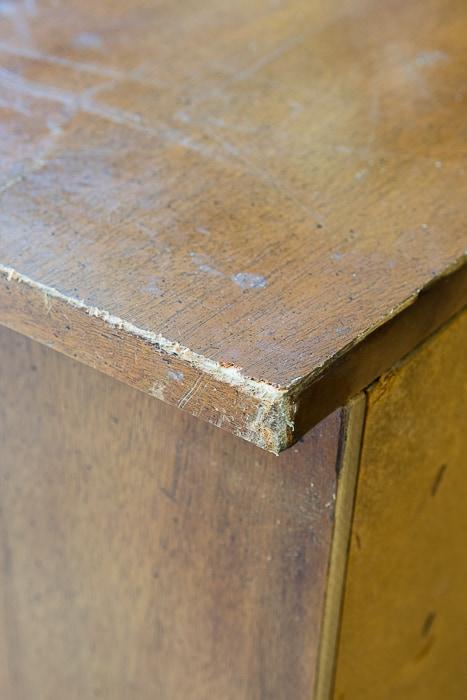 Picture of damaged corner of wood dresser