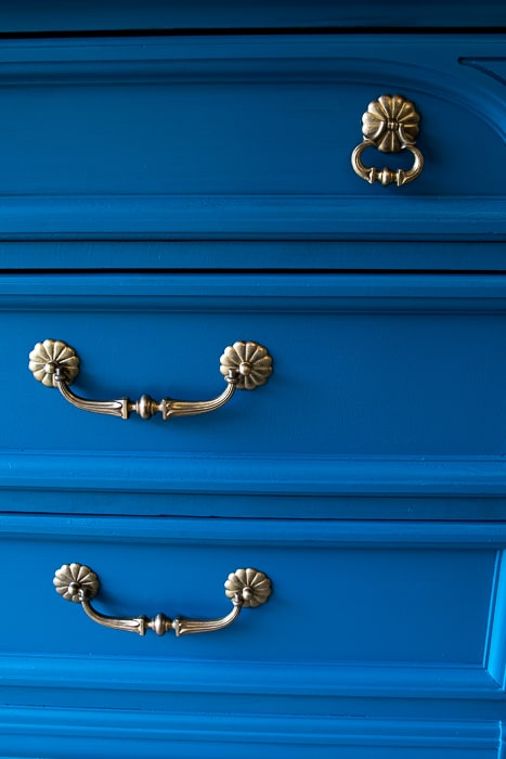 Picture of painted dresser drawers and gold hardware
