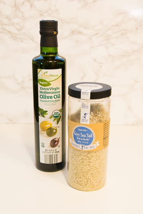 Picture of bottle of olive oil and canister of gray sea salt