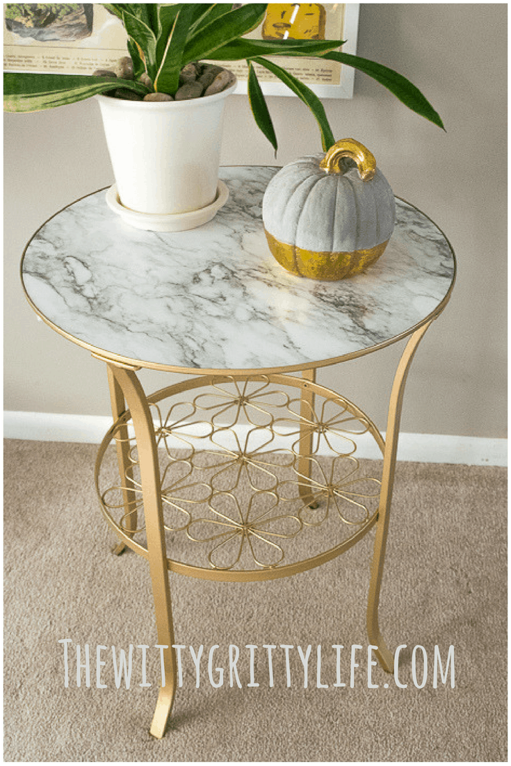 picture showing completed Ikea table make over with gold paint and marble shelf liner paper