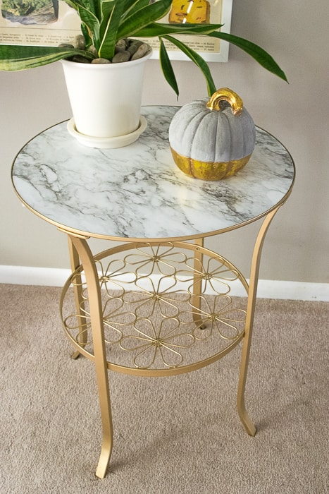 picture of finished Ikea Klingsbo table spray painted gold with marble top