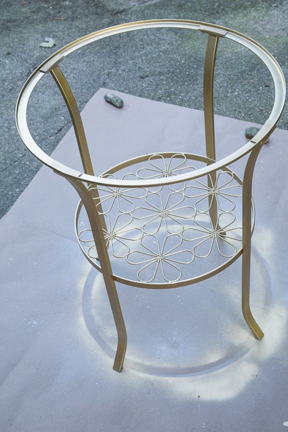 picture of round metal table spray painted gold