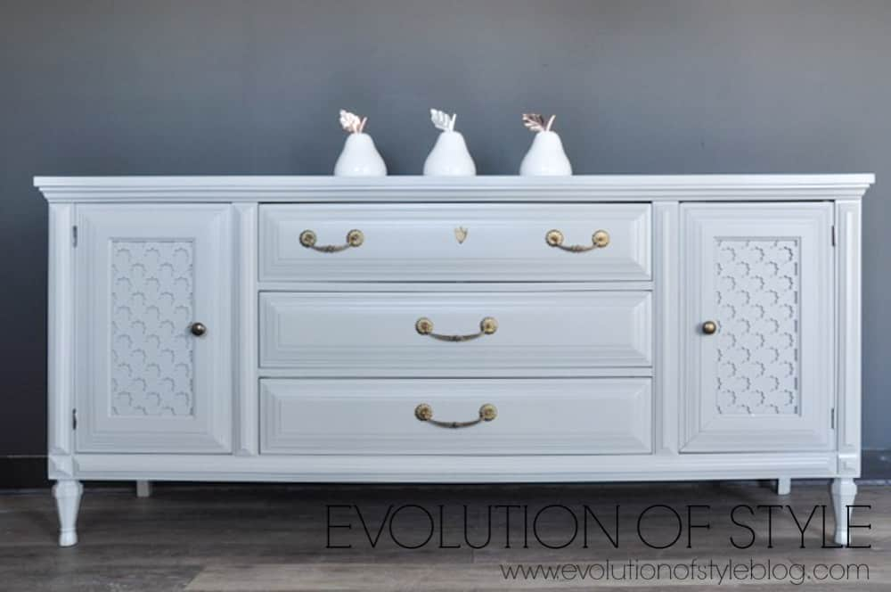 picture showing light gray dresser with three white ceramic pear sculptures
