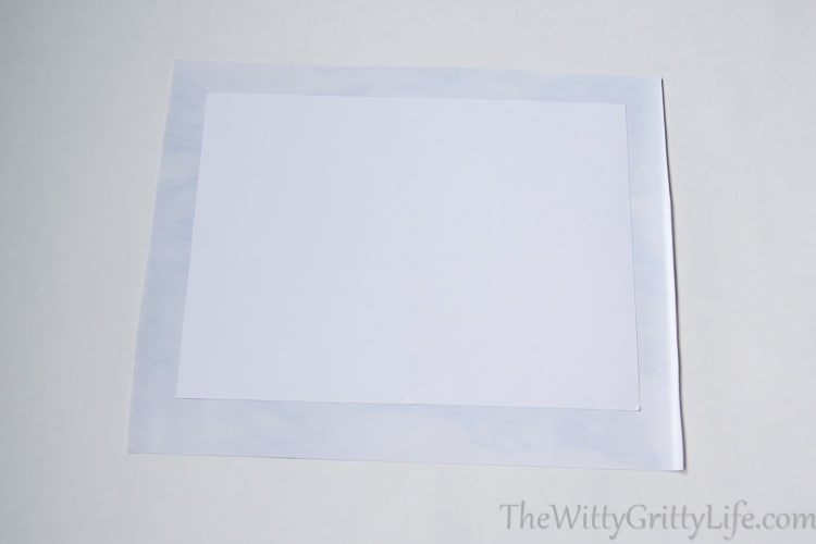 picture of white cardboard on adhesive shelf liner paper