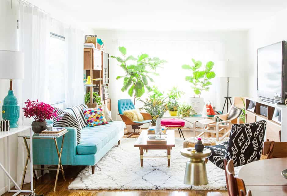 A wonderful example of a bright and happy, colorful living room decorated mid century modern style