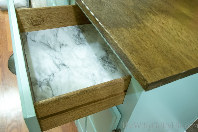 drawer all redone and lined with marble shelf paper
