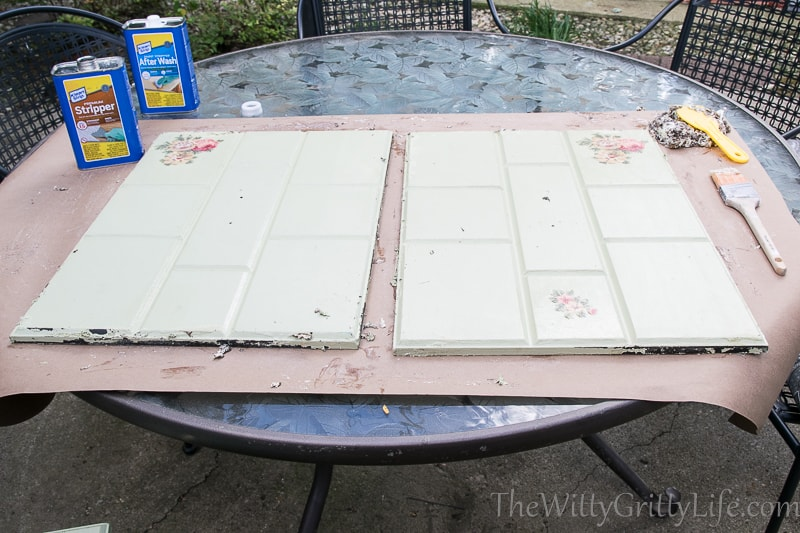 the cabinet doors outside with the first coat of stripper applied