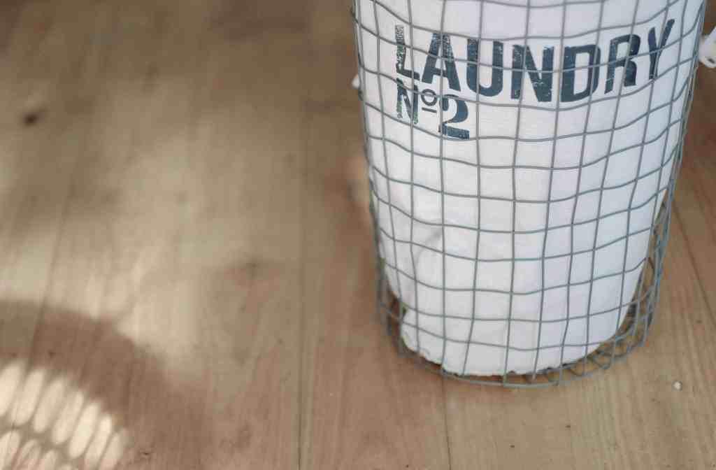 laundry basket on wood floor