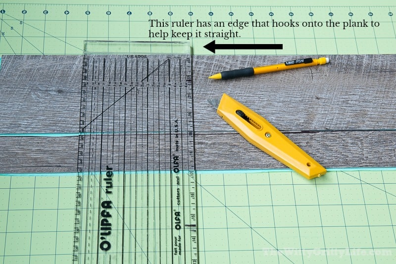 Graphic showing the edge of the ruler that hooks to the plank