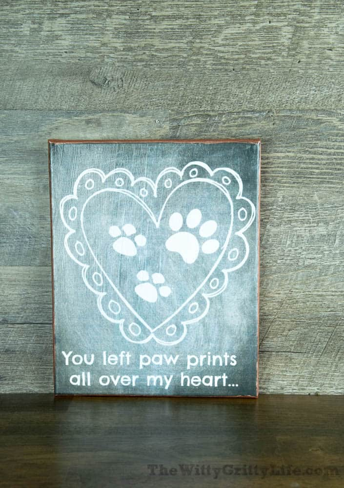 """Diy wall sign with quote """"you left paw prints all over my heart""""."""